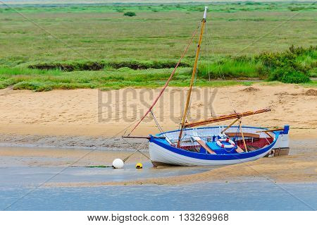 Sailing dinghy beached at Brancaster Staithe in Norfolk