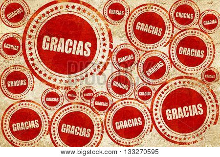 gracias, red stamp on a grunge paper texture