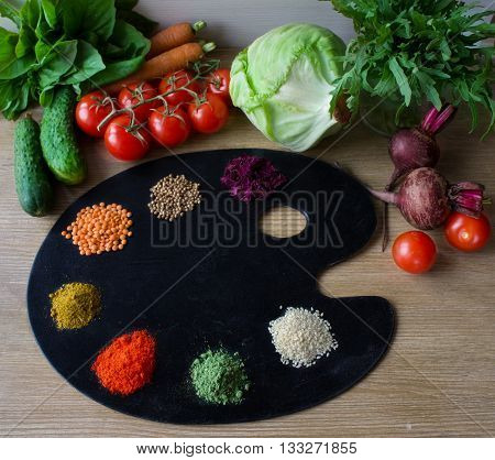 Painting palette with various spices and herbs on color wooden background