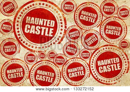 haunted castle, red stamp on a grunge paper texture
