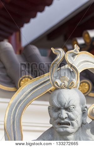SINGAPORE - AUGUST 6, 2014: Detail from the Buddha Tooth Relic Temple in Singapore. The temple was opened at 2007 and become a popular attraction within Singapore Chinatown.