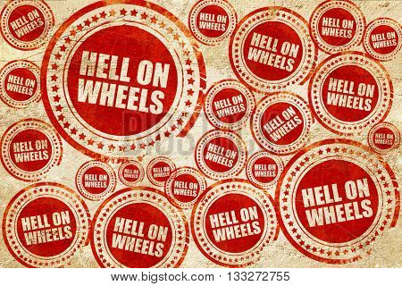 hell on wheels, red stamp on a grunge paper texture