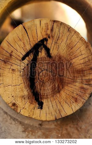 Surface timber marked with arrows on the surface.