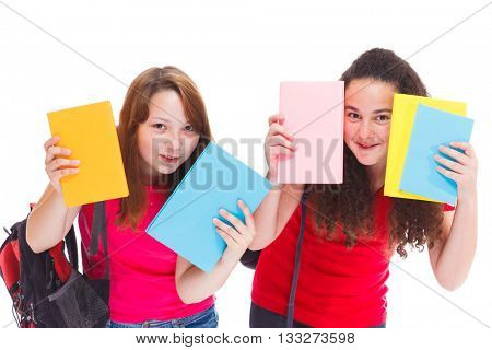 Two high school students hiding behind books