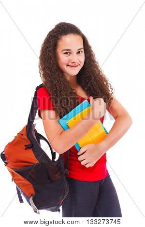 Smiling teenage girl with backpack and books, isolated