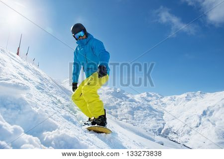 Recreation vacation at a ski resort - snowboarder enjoying snow in the mountains