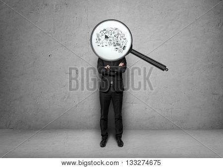 Businessman stands with folded arms with magnifier instead of head. Economic and statistical graphs displayed through the magnifier. Deep research. Full concentration. Business idea. The beginning of the business plan. The obsession with the business idea