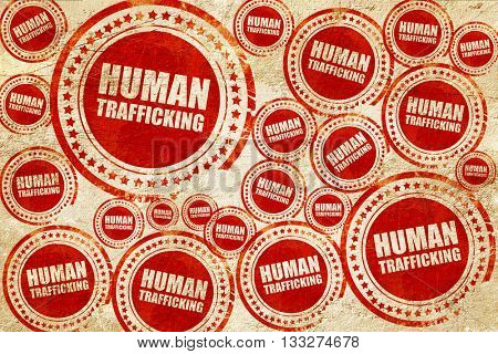 human trafficking, red stamp on a grunge paper texture