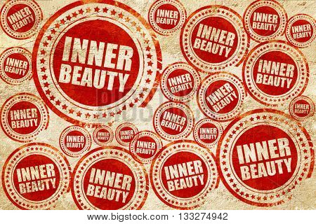 inner beauty, red stamp on a grunge paper texture