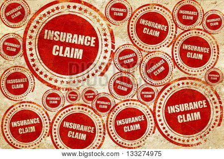 insurance claim, red stamp on a grunge paper texture