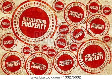 intellectual property, red stamp on a grunge paper texture