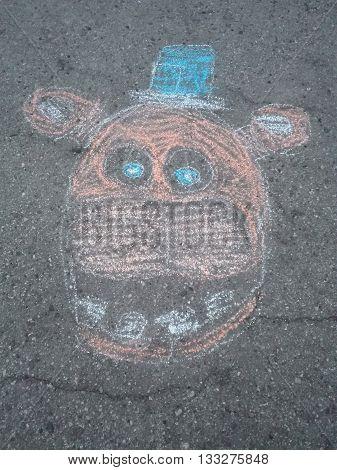 Freddie Teddy bear drawn on asphalt with chalk