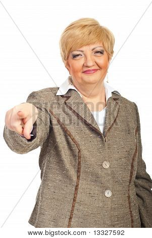 Smiling Mature Business Woman Pointing To You