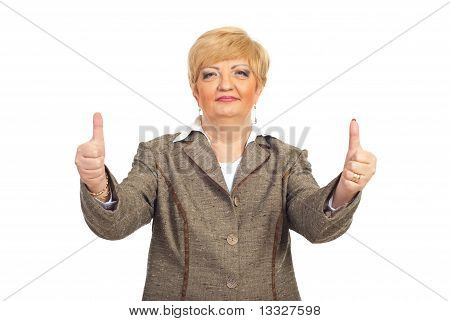 Mature Business Woman Giving Thumbs Up
