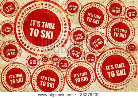 it's time to ski, red stamp on a grunge paper texture