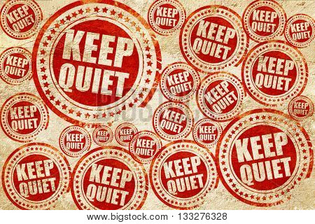 keep quiet, red stamp on a grunge paper texture
