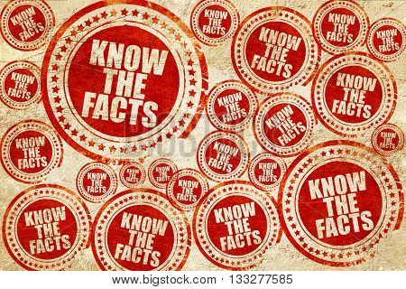 know the facts, red stamp on a grunge paper texture