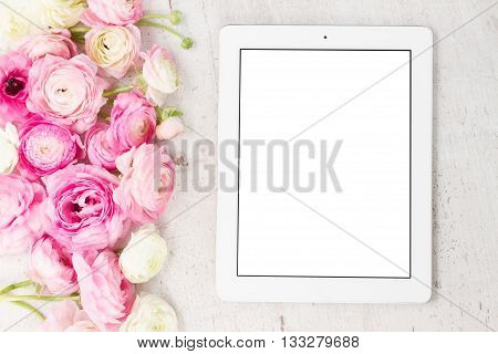 Pink and white ranunculus flowers styled flat lay scene