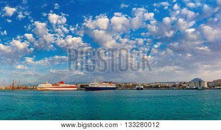 Passenger ships in the sea port, loading, unloading cranes in cargo port of Heraklion, Crete, Greece. Panorama