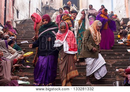 AYODHYA, INDIA - JAN 27, 2013: Visitors of the Hindu Temple give alms to the poor people at morning on January 27, 2013 in India. The temple was built by the Nawab of Avadh in 10th century
