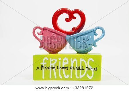 A sign decoration for friendship against a white background