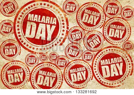 malaria day, red stamp on a grunge paper texture