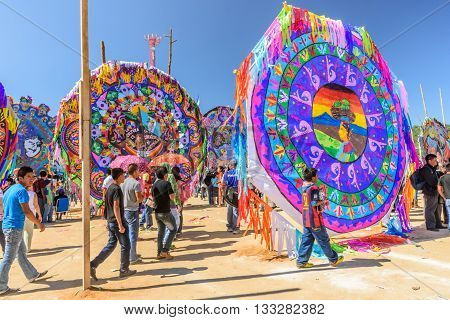 Sumpango Guatemala - November 1 2015: Visitors & handmade kites with different themes at giant kite festival honoring spirits of dead on All Saints' Day.