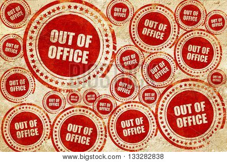 out of office, red stamp on a grunge paper texture