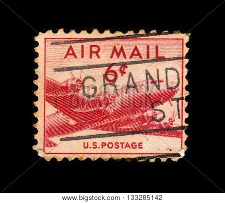 USA - CIRCA 1949: a stamp printed in USA shows Douglas DC-4 Skymaster, four-engine propeller driven airliner developed by the Douglas Aircraft Company, circa 1949