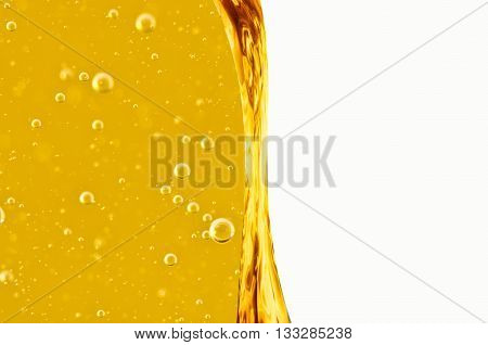 Liquid flows yellow for the project oil honey beer or other variants on white background area for text.