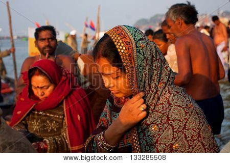 ALLAHABAD, INDIA - JAN 27, 2013: Beautiful indian woman goes to Sangam through the crowd at the biggest Earth event Kumbh Mela on January 27, 2013 in India. Mela '13 will take 130 000000 visitors