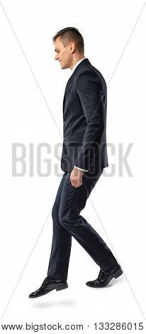 Side view of businessman down the stairs , isolated on white background. Business staff. Office clothes. Dress code. Presentable appearance. Self-confidence.