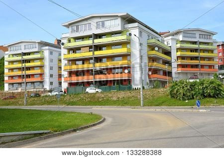Zilina, Slovakia - June 4, 2016: Group of coloured apartment dwelling houses next to the public route