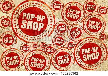 pop-up shop, red stamp on a grunge paper texture