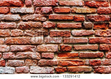 The old red brick wall texture .