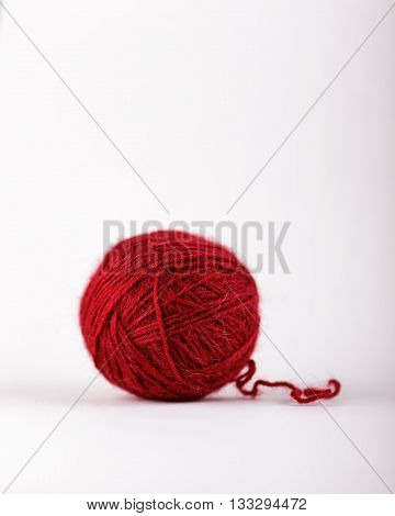 Tangle of red wool for knitting. Best Natural toys for cats.