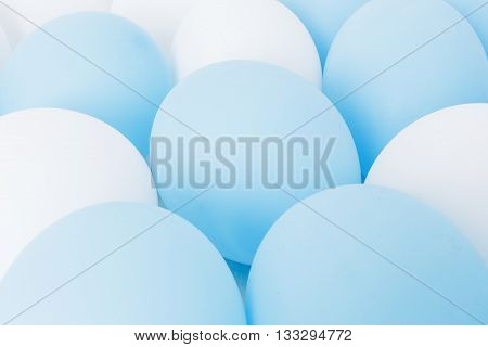 Inflated balloons white and blue. preparation for celebrations, weddings. The background for greeting cards, invitations