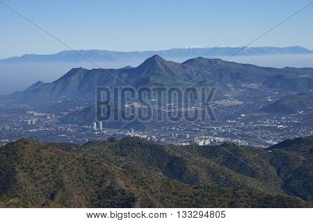 Panoramic view of Santiago, capital of Chile. Viewed from Parque Puente Nilhue in the foothills of the Andes Mountains looking towards Cerro Manquehue (1,635m).