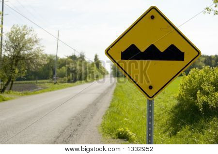 Yellow Caution Sign Warning Bumpy Road Ahead