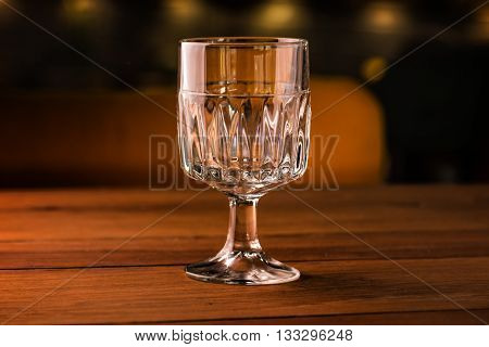 Empty coctail glass on table in night club