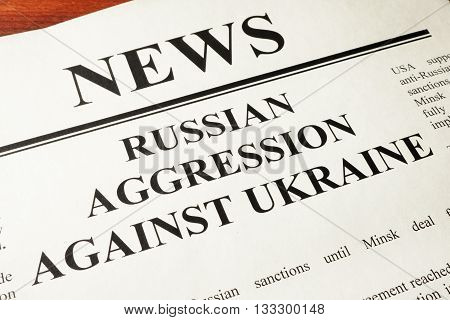 Newspaper with word news and Russian Aggression Against Ukraine.