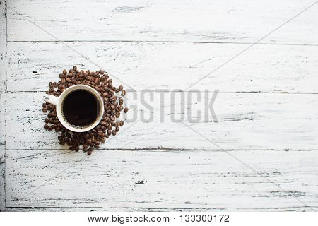 A Cup Of Coffee On A White Wodden Background
