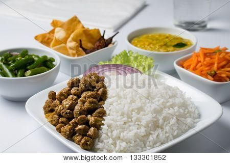 Sri Lankan rice and curry on white background