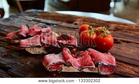 bruschetta with roasted beef and tomatoes. Shallow dof