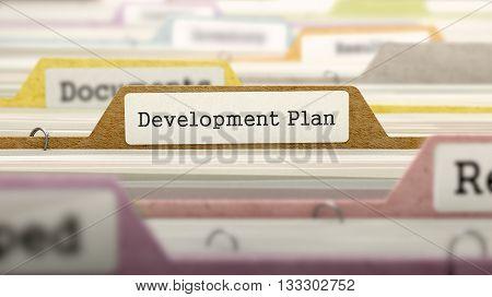 Development Plan Concept on File Label in Multicolor Card Index. Closeup View. Selective Focus. 3D Render.