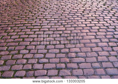 background texture from red colored cobblestone pavement