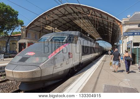 Avignon, France. July 2015. A TGV service is on the platform of Avignon Ville station. Unidentified people.
