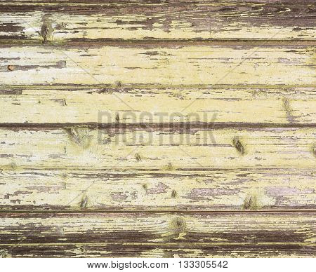 Grunge background. Peeling paint on an old wooden wall.