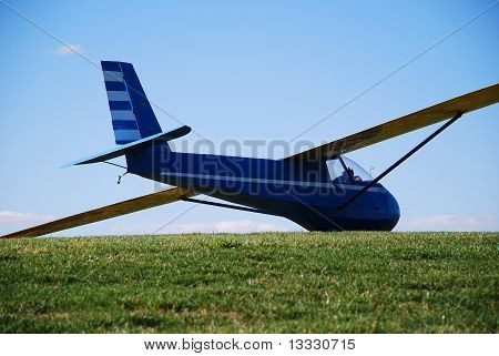 Glider parked on grass