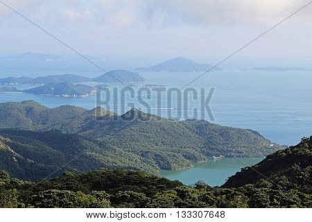 Beautiful view of the bay in the South China Sea in the summer with the Lantau Island. Hong Kong.